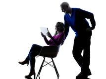 Couple senior digital tablet computer silhouette Stock Photos