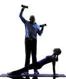 Couple senior fitness exercises silhouette Royalty Free Stock Images