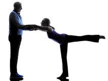 Couple senior fitness exercises silhouette Royalty Free Stock Image