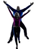 Couple senior jumping happy silhouette Stock Images