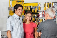 Couple With Senior Man In Hardware Shop Stock Photos