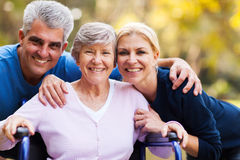Couple senior mother. Portrait of mid age couple and senior mother outdoors stock images