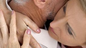 Couple of senior people hugging tenderly outdoors, love and support, closeup. Stock photo royalty free stock images