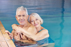 Couple senior people in swimming. Happy couple senior people bathing in a swimming pool stock photography