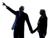 Couple senior pointing silhouette royalty free stock photography