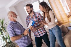 Couple with real-estate agent visiting house for sale. Couple with senior real-estate agent visiting house for sale stock images