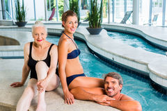Couple and senior relaxing in wellness spa. Couple and senior in swimwear relaxing in wellness spa royalty free stock photography