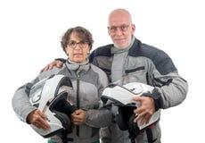 Couple senior riders with helmet isolated on the white backgroun Stock Photo