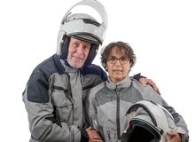 Couple senior riders with helmet isolated on the white backgroun Royalty Free Stock Photo