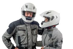 Couple senior riders with helmet isolated on the white backgroun Royalty Free Stock Photos