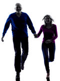 Couple senior running happy silhouette Stock Images