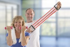 Couple of senior sporty pair exercising on fitness trail royalty free stock images