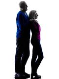Couple senior standing looking away silhouette Stock Image