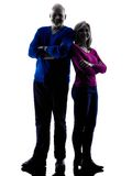 Couple senior standing  silhouette Stock Photos
