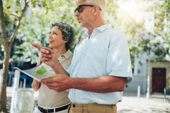 Couple of senior tourists reading a map Stock Image
