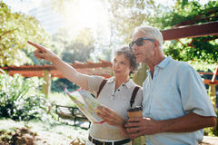 Couple of senior tourists using a city map Royalty Free Stock Images