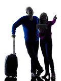 Couple senior travelers traveling silhouette Royalty Free Stock Image