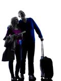 Couple senior travelers traveling silhouette. One caucasian couple senior travelers traveling  silhouette  in silhouette studio isolated on white background Royalty Free Stock Photos