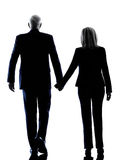 Couple senior walking rear view silhouette Stock Images