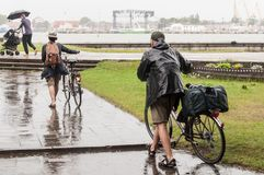 Couple seniors of cyclists in rainy day royalty free stock image