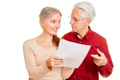 Couple of seniors with letter with bad news royalty free stock images