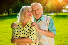 Couple of seniors outdoors. Royalty Free Stock Images