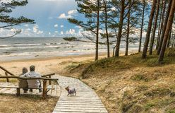 Couple of seniors are resting near a beach of the Baltic Sea stock photo