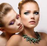 Faces of Two Sensual Pretty Women Closeup Royalty Free Stock Photography