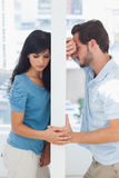Couple are separated by white wall Stock Image