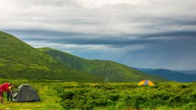 Couple Setting up Camp Tent in the Mountains. Time Lapse stock video footage
