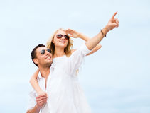 Couple in shades at sea side Stock Photography