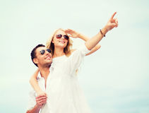 Couple in shades at sea side Royalty Free Stock Images