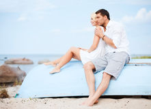Couple in shades at sea side Royalty Free Stock Photo