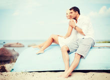 Couple in shades at sea side Royalty Free Stock Photos
