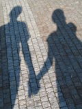 Couple shadow. A shadow of a girl and boy Royalty Free Stock Image