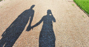 Couple shadow. Couple hand in hand shadow Royalty Free Stock Photos