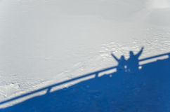 Couple shadow on the snow Royalty Free Stock Images