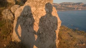 Couple. Shadow of the couple on the stone Royalty Free Stock Image