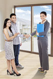 Couple shaking hands with real estate agent Royalty Free Stock Photo