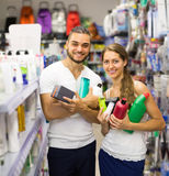 Couple with shampoo in the store Royalty Free Stock Photography
