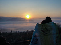 COUPLE SHARING BLANKET WATCHING SUNRISE Royalty Free Stock Image