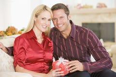 Couple Sharing Christmas Present Stock Photography