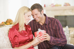 Couple Sharing Christmas Present Stock Photo