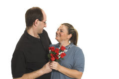 Couple sharing flowers Stock Photo