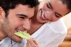A couple sharing food. Royalty Free Stock Images