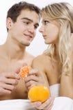 Couple sharing fruit Stock Image