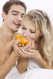 Couple sharing mandarin Stock Images