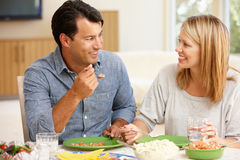 Couple sharing meal Royalty Free Stock Photography