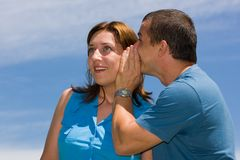 Couple sharing secrets Stock Image