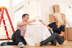 Couple Sharing Takeaway Meal In New Home Royalty Free Stock Image